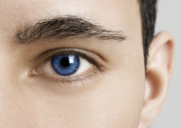 Close-up portrait of a young man with blue eyes - OBS: model use lens contact