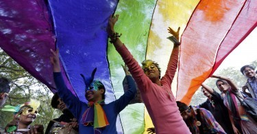 Participants dance under a a rainbow flag as they attend the sixth Delhi Queer Pride parade, an event promoting gay, lesbian, bisexual and transgender rights, in New Delhi November 24, 2013. Hundreds of participants on Saturday took part in a parade demanding freedom and safety of their community, according to a media release. REUTERS/Mansi Thapliyal (INDIA - Tags: SOCIETY TPX IMAGES OF THE DAY)