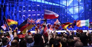 Supporters wave flags ahead of the Eurovision Song Contest 2014 Grand Final in Copenhagen, Denmark, on May 10, 2014. AFP PHOTO/JONATHAN NACKSTRAND        (Photo credit should read JONATHAN NACKSTRAND/AFP/Getty Images)