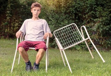 18--photodune-13495139-lonely-teenage-boy-with-two-chairs-l