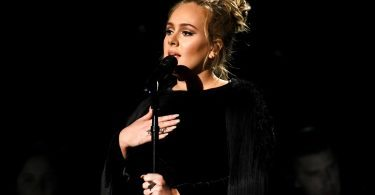 Adele performing a George Michael tribute at the Grammys