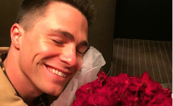 Colton Haynes with roses